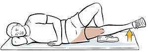 Man lying on his side doing straight leg raises to work the internal muscle.