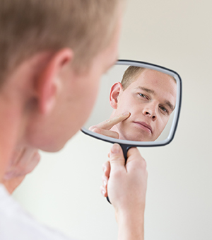 Man looking in mirror.